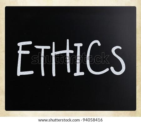 """Ethics"" handwritten with white chalk on a blackboard - stock photo"