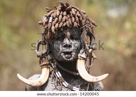 ETHIOPIA - UNKNOWN: The Mursi (or Murzu) nomadic cattle herder ethnic. Debub Omo Zone. in this undated image taken in  Ethiopia. - stock photo