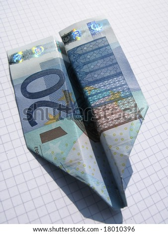 20-Euro airplane on squared paper - stock photo