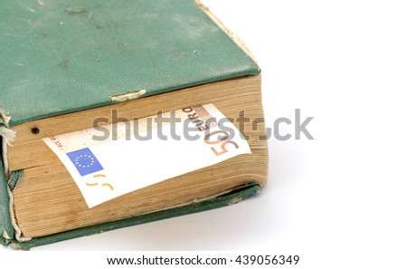 euro banknote  between pages of an  old weathered book. education cost - stock photo