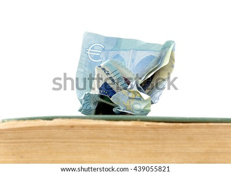 euro banknote on  an old weathered book. education cost - stock photo
