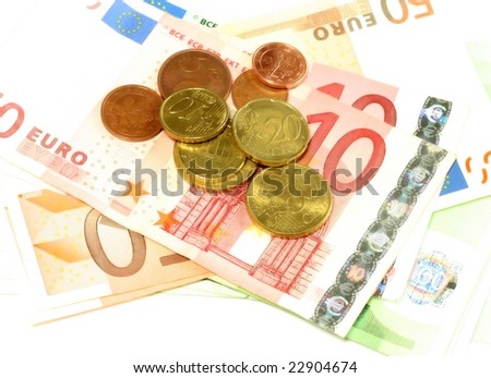 euro banknotes and coins, isolated on white background