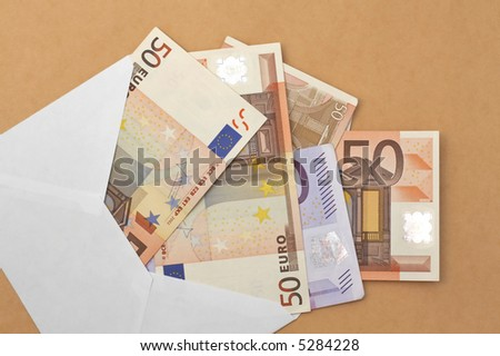 50 euro banknotes coming out of an envelope, wealth concept, receiving money