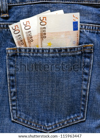Euro banknotes in the pocket of a blue jeans.