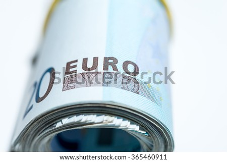 20 euro banknotes rolled and wrapped together