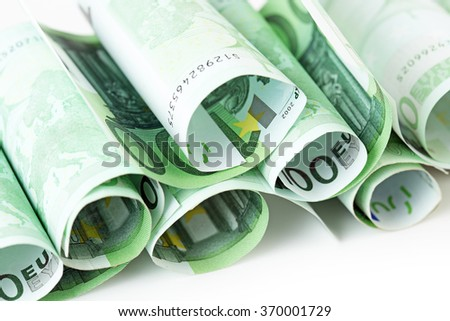 100 euro banknotes rolled up on white background - stock photo