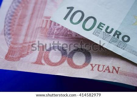 100 euro bill and 100 rmb - stock photo