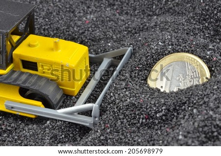 1 euro coin buried from excavator - stock photo
