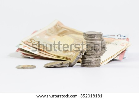 2 euro coins stacked and euro banknotes on a white background  - stock photo