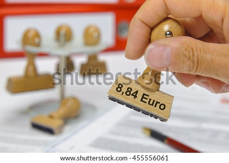 8,84 Euro minimum wage in Germany printed on rubber stamp