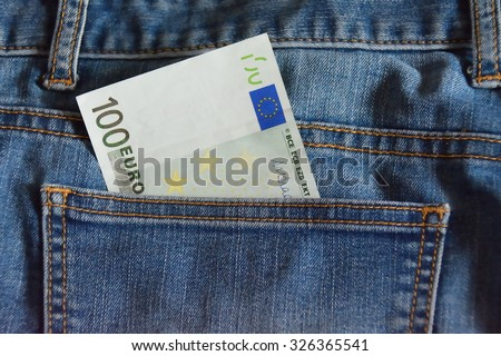 100 euro note in the blue jeans pocket, closeup - stock photo