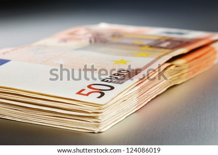 2000 Euro on a shiny polished aluminum board - stock photo