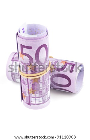 500 Euro rolled up on white background. Five thousand euro banknotes rolled up on white background. WITH CLIPPING PATH. - stock photo