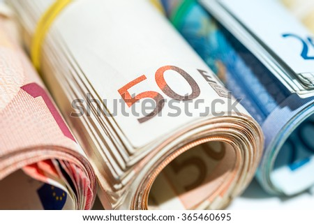 50 Euros banknotes rolled and wrapped together