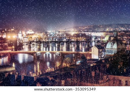 Evening View of The Vltava River and Bridges in Prague, Czech republic. Bokeh light effect, soft filter. Instagram toning effect. - stock photo