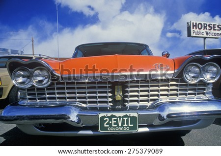 2-Evil License Plate on 1957 Plymouth - stock photo
