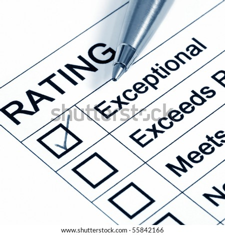 """Excellent"" rating, with ballpoint pen.  Blue toned image. - stock photo"