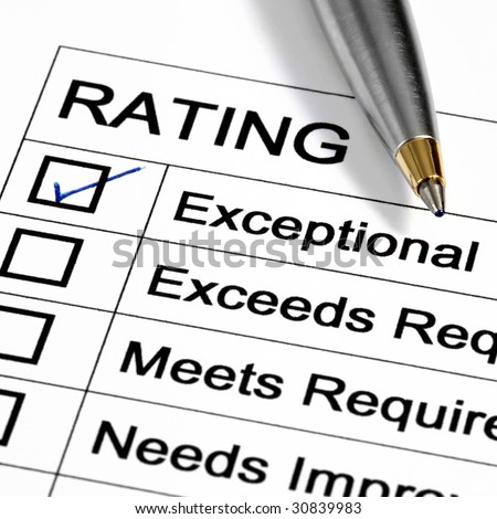 """Exceptional"" rating marked with pen.  Could be performance appraisal, customer service rating, business performance evaluation. - stock photo"