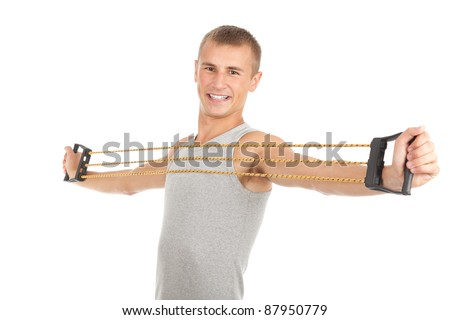 exercising young man in casual shirt with expander, white background