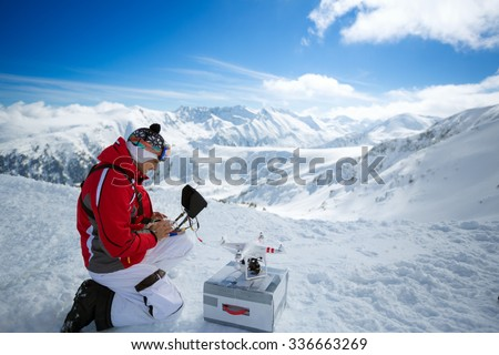 Expert male engineer with remote controls quadrocopter drone a the mountains  - stock photo
