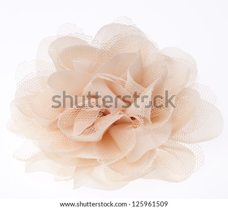 Fabric flower on white background - stock photo