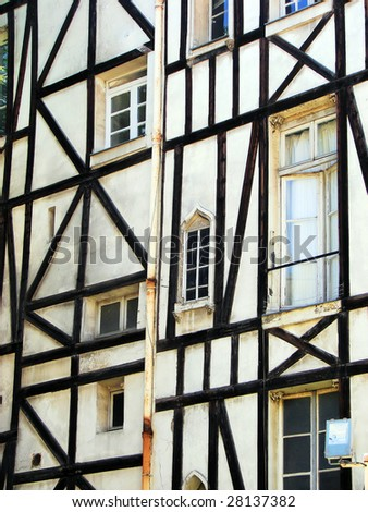 facade of  ancient house in paris, france