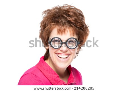 Face expressions and people concept - portrait of smiling teenage girl in funny glasses