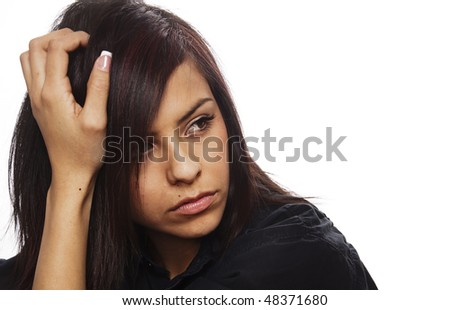 Face of a sad young woman ( acting ) - stock photo