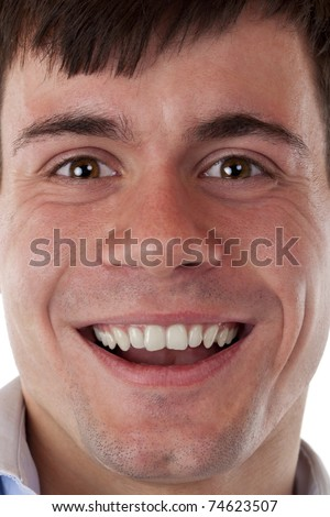 Face of a young, happily smiling man. Isolated on white background. - stock photo
