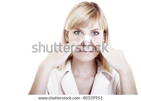 Face of young woman with sticking plaster on nose on the white background - stock photo