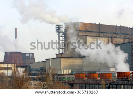 factories pollute the environment. Smoke from factory chimneys.