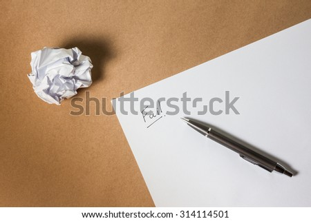 """""""Fail"""" hand writing on paper, pen and crumpled paper. Business frustrations, Job stress and Failed exam concept. above shot. - stock photo"""