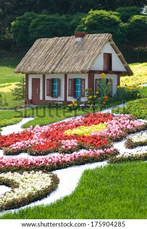 Fairytale cottage (made of flowers). Ukraine, Kiev, Singing field. - stock photo