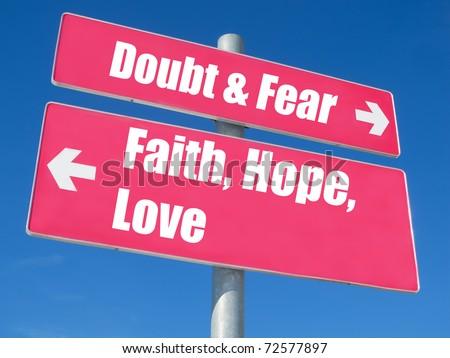 """""""Faith, Hope, Love vs. Doubt & Fear"""" signpost against blue sky - stock photo"""