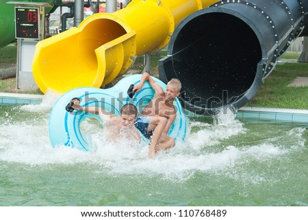 falling into water in the aquapark - stock photo