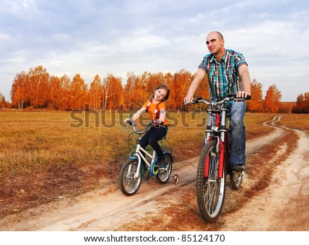 family on bike - stock photo