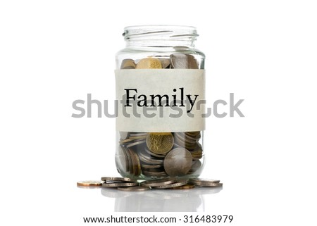 """Family"" text label on full coins of jar spill out from it isolated on white background - saving, donation, financial, future investment and insurance concept - stock photo"