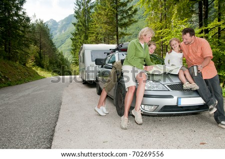 Family with camping car on the road - stock photo