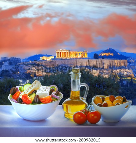 Famous Acropolis with Greek salad in Athens, Greece - stock photo