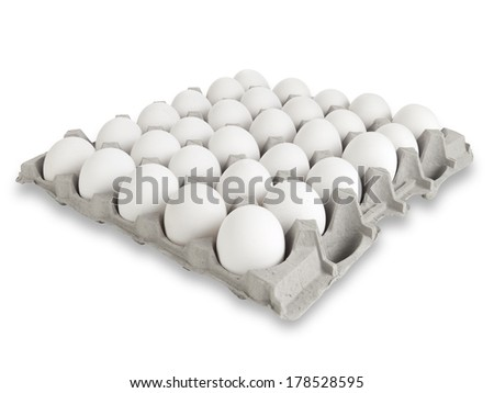30 farm fresh white eggs in a tray isolated with clipping path - stock photo