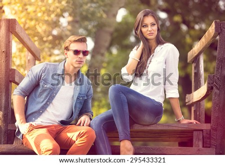 Fashion couple together enjoy in park - stock photo
