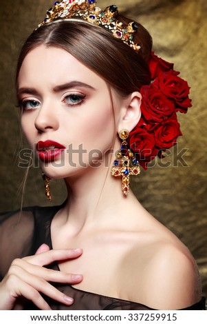 Fashion girl portrait.Accessorys.Gold background - stock photo