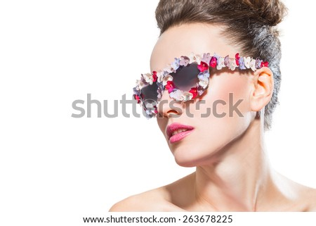Fashion model in trendy sunglasses and hairdo isolated over white background - stock photo