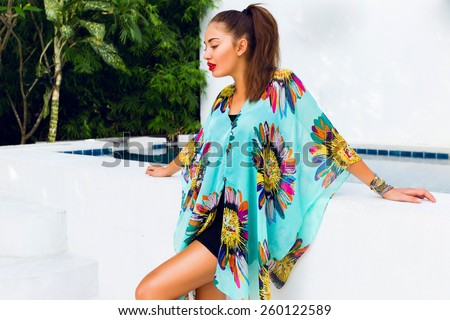Fashion outdoor portrait of elegant   sensual woman  with red lips in bright blue  boho dress and colorful stylish accessories.  - stock photo