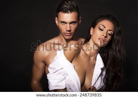 fashion photo of sexy impassioned couple posing in studio   - stock photo