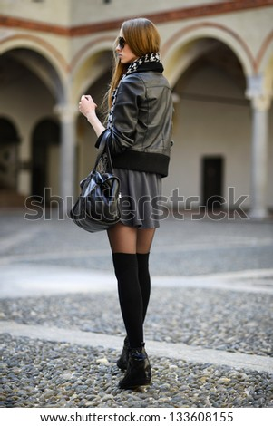 Fashion woman in sunglasses walking on the street - stock photo