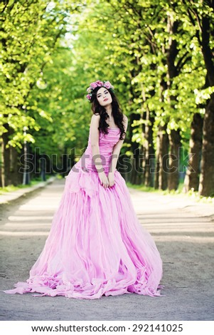 Fashion Woman Outdoors. Fashion Girl on Summer Greenery Background
