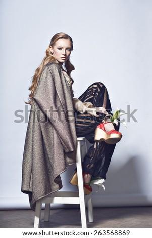 fashion woman trousers strips blouse jacket shoes  - stock photo