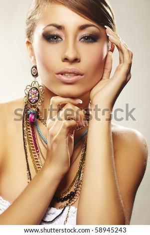 fashion woman with jewelry on light bacground - stock photo