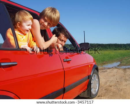 father   and children in car - stock photo